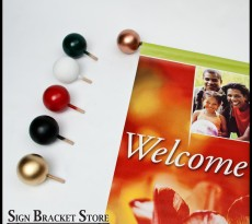 Attractive, easy and affordable, painted ball finials instantly improve year-round banner brackets for the holiday season