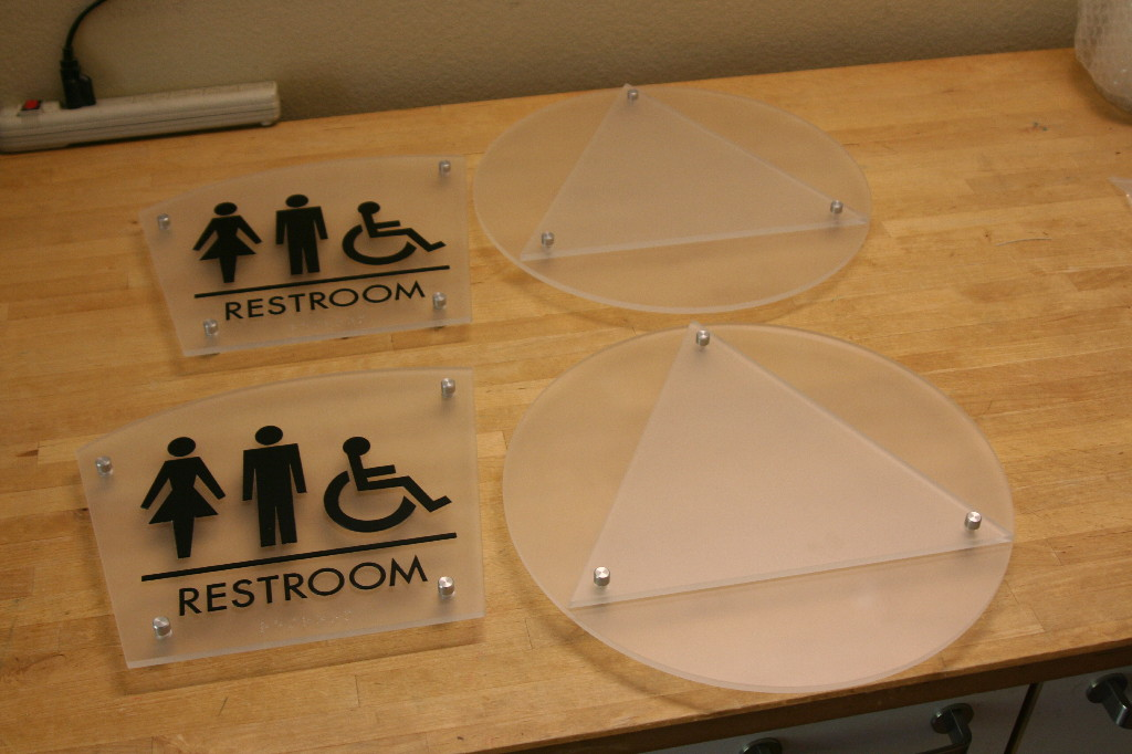 Standoffs lend well to ADA compliant signage like these restroom signs.