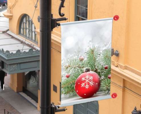 Holiday-themed banner bracket with red ball finials