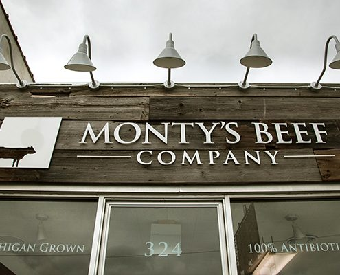Storefront Lighting - Aluminum Gooseneck Lights at Montys Beef Company