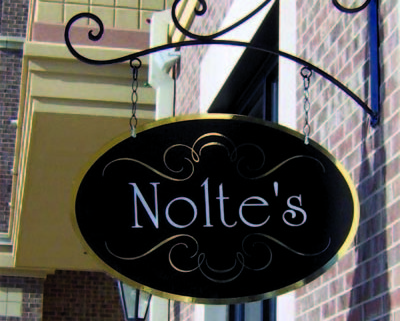 Design Tip: Use sign brackets that accentuate the shape of your sign.