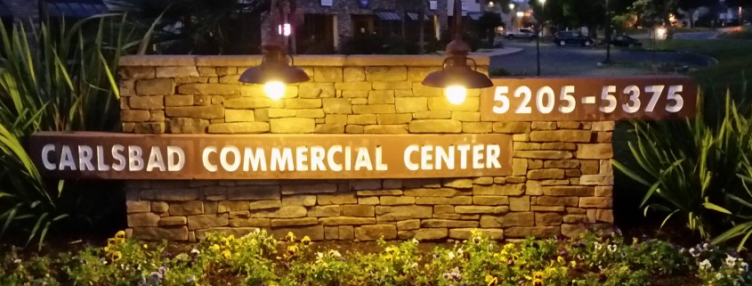By night, gooseneck fixtures direct light to feature the sign's message clearly for drivers.